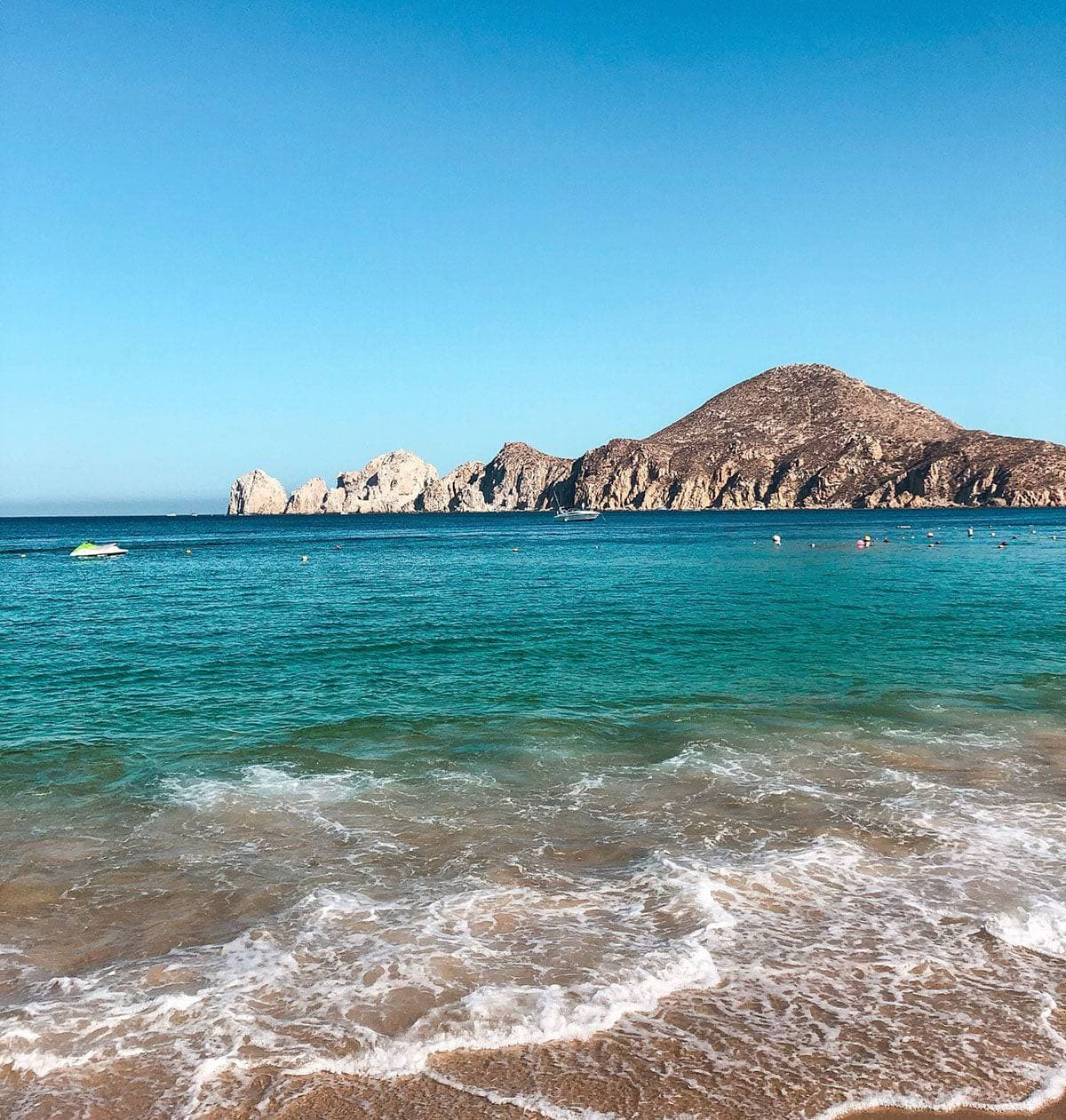 beach in cabo san lucas with mountain in the back
