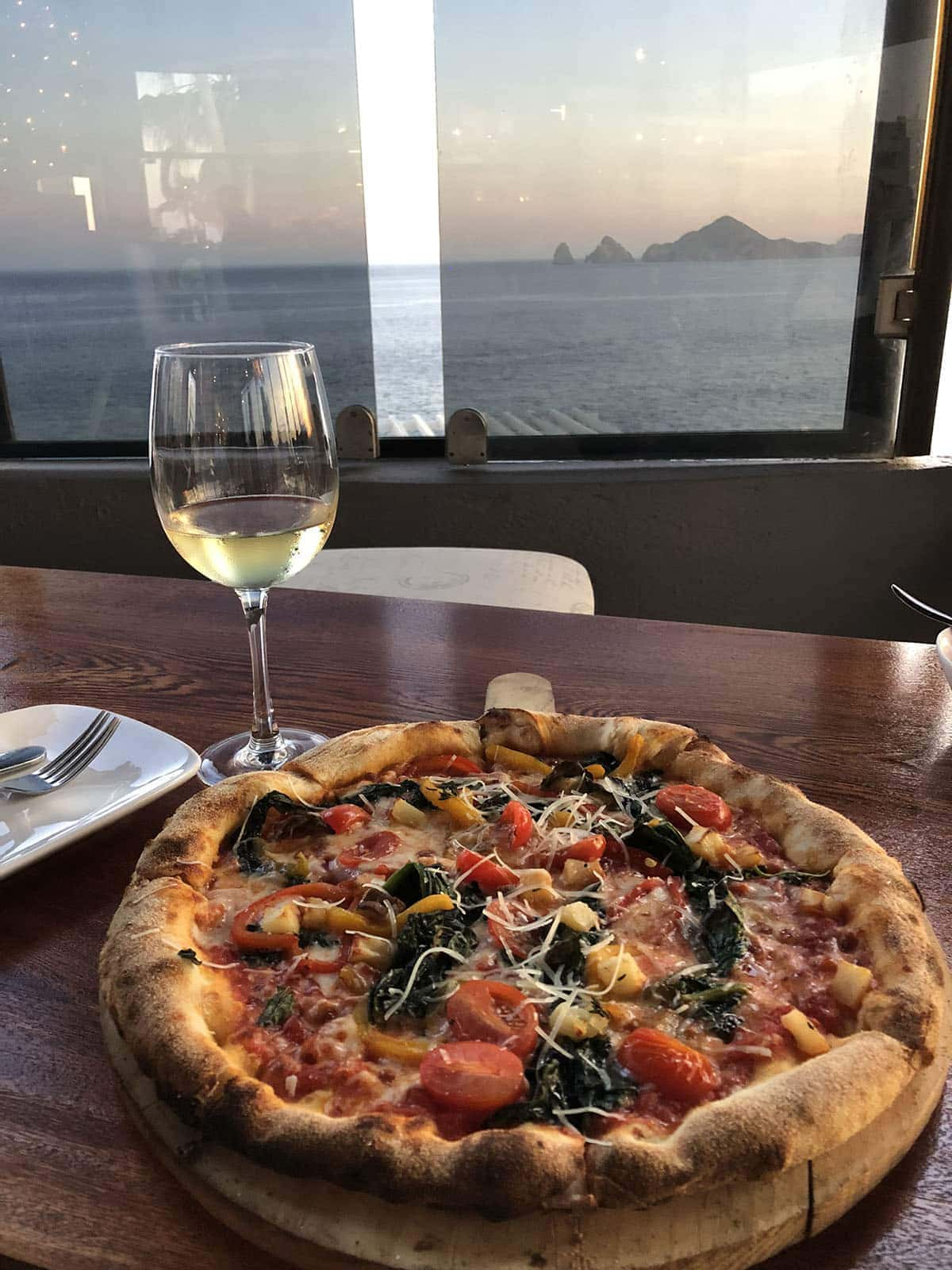 pizza and wine during sunset