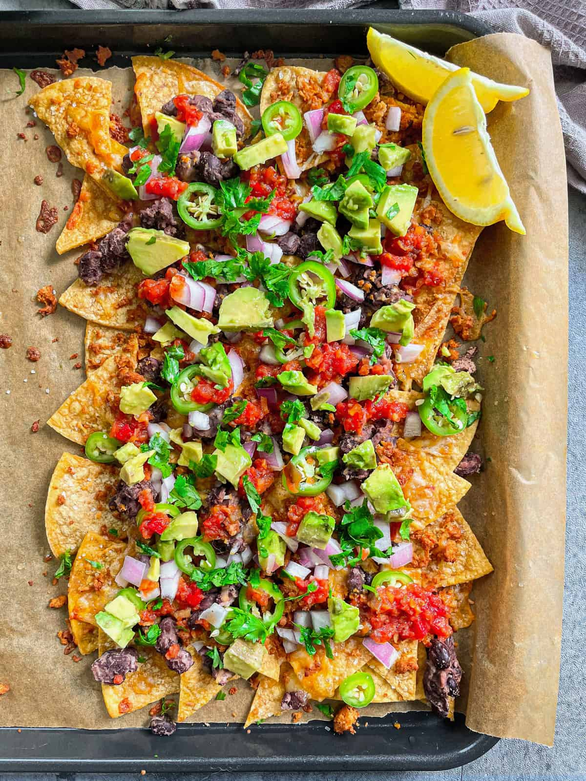 The Ultimate Loaded Vegan Nachos with ground beef in a Sheet Pan