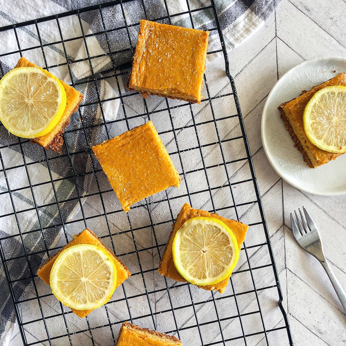 mango lemon shortbread bars overhead shot on cooling rack with lemon slices on top featured