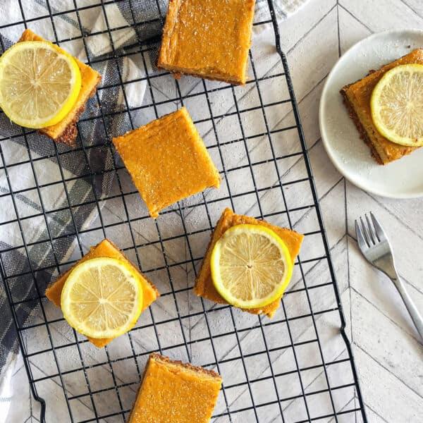 mango lemon shortbread bars overhead shot on cooling rack with lemon slices on top