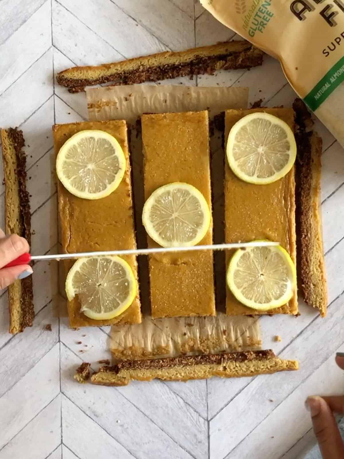 cutting the lemon shortbread bars into squares